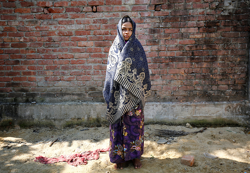 Mortaza Bibi, a Rohingya refugee who currently takes shelter with a local Bangladeshi family, poses for a photograph in Teknaf near Cox's Bazar, Bangladesh, November 22, 2016. REUTERS/Mohammad Ponir Hossain TPX IMAGES OF THE DAY